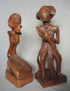Two wood carvings; of a Baris dancer and a kneeling woman - Bali - Indonesia