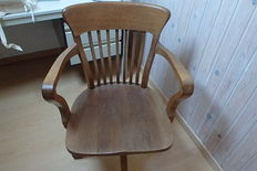 Industrial American office chair in oak wood with saddle seat - ca. 1930