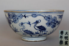 Porcelain bowl with a blue-white painting with cranes - China - probably 17th century.