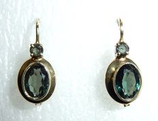 Earrings 14kt / 585 gold with 4 tourmalines of 1.5ct.  Dangle earrings.