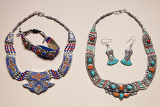 Two sets of Tibetan-style jewellery items - turquoise and treated coral, lapis lazuli paste and hallmarked 925 silver