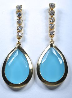 18 kt  Articulated cocktail earrings with white zirconias and big tear drop shape blue zirconia