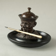 Chinoiserie - a bronzed metal inkwell on a blackened wooden pencil holder - circa 1890