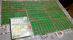 8 wooden coin trays + world coins catalogue