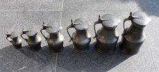 A set of pewter acorn jugs Tudor Rose stamped - 19th century