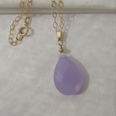 Gold necklace with large facetted chalcedony in purple-violet.