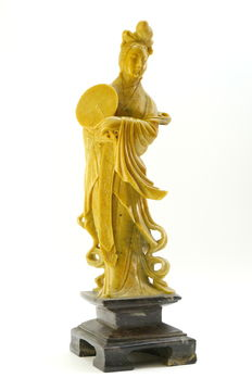 Great Goddess Guanyin holding in her hand a fan in soapstone – China – middle of 20th century.