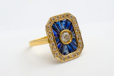 Yellow gold 18 karat, antique ring with sapphires and 25 diamonds.
