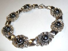 An antique 925 silver bracelet with haematite beads from Russia around 1927, 20 cm length