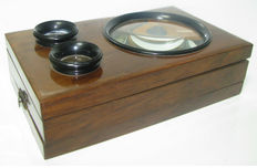 Antique viewer stereoscope - wooden graphoscope to look at pictures in relief and with magnifying glass
