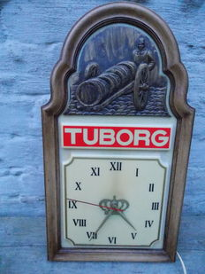 Illuminated advertising sign and clock for Tuborg.