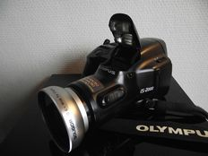 Olympus IS-2000 camera with SOLIGOR 0.6x WIDE lens 35-135mm F4.5-5.6 and diameter 52mm