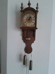 Old long-pendulum clock