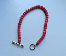 Baby bracelet of red coral with 14 tk gold clasp.