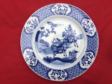 Blue and white plate with rabbit hunt scene  - China - first half 18th century