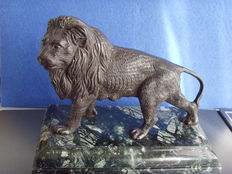 Bronze sculpture of a lion on green marble pedestal - probably Southern Europe - 1st half of 20th century