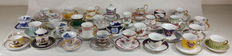 Lot of 30 hand-painted porcelain mignon cups