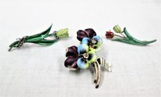 Three silver enamelled brooches