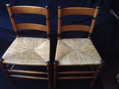 Two old Dutch chairs - oak - decorated with black painted accents - rush seats
