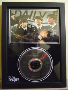 The Beatles, framed photo and  CD disc. 'I Want to Hold Your Hand', Parlophone label.