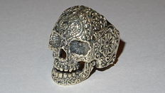 Heavy first grade silver tooled skull ring with floral patterns