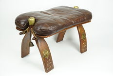 Beautiful vintage oak camel saddle with leather patchwork seat and copper metalwork.