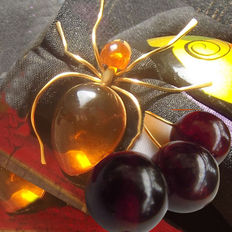 Collection of two Amber brooches, spider and cherries, 11 grams