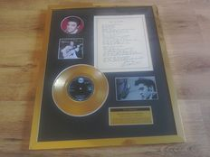 """Elvis Presley """" Blue Suede Shoes """"24kt gold plated record and facsimile of handwritten lyrics display ."""