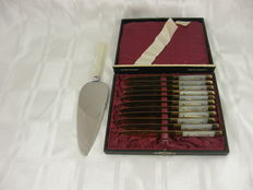Case with 11 gilded fruit knives with mother of pearl hilt and a large cake server with mother of pearl handle, England and Germany, mid 20th century