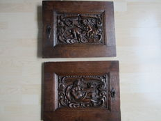 Two early cabinet doors with very fine cut relief panels and iron locks - early 17th century