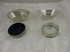 Set with 2 open work silver plated chocolate baskets and 2 openwork silver plated bottles holders with insert, Netherlands and England, mid 20th century