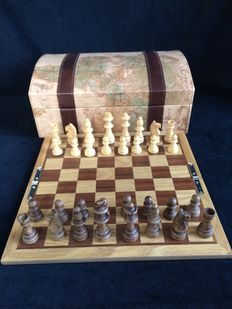 Chess set, backgammon and various other games in a chest with map decorations