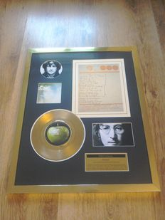 "John Lennon "" Imagine ""24kt gold record and facsimile of handwritten lyrics display ."