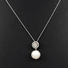 Choker with white gold pendant, diamonds, and freshwater pearl.