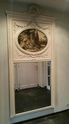A Louis XVI style carved wood and gesso overmantle mirror - with a scene painted on canvas - Netherlands - 19th century