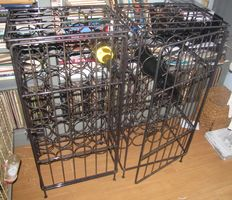 Two very solid wine racks with door, forged, 2 x 32 bottles.
