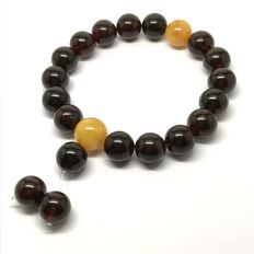 Tibetan style bracelet mala with Baltic amber beads of 11-12 mm in diameter - cherry and butter