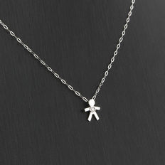 18 kt white gold necklace and human-shaped pendant, with a brilliant cut diamond weighing 0.03 ct in total