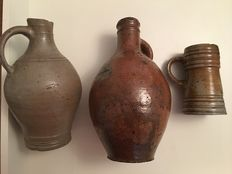 Collection of German stoneware: Beer pull, oil jar and jug with three rims
