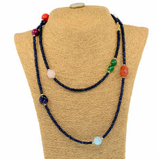 Long necklace with sapphires and multiple other gemstones with 18kt (750/1000) yellow gold clasp