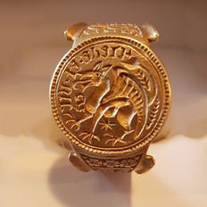 "Medieval Golden Henry VII ""Believe and Conquer""Signet glove ring - 29mm overall, 25.24mm internal diameter (1 1/8"")."