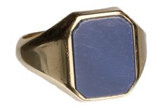 Yellow gold signet ring set with a grey stone