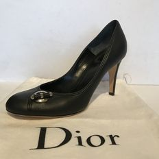 Christian Dior – black courts.