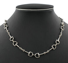 Silver choker composed of links in equestrian design.
