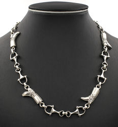 Heavy silver choker composed of links in equestrian design.