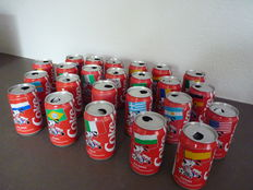 Coca Cola cans, 24 countries World Cup football and various Always Coca Cola items