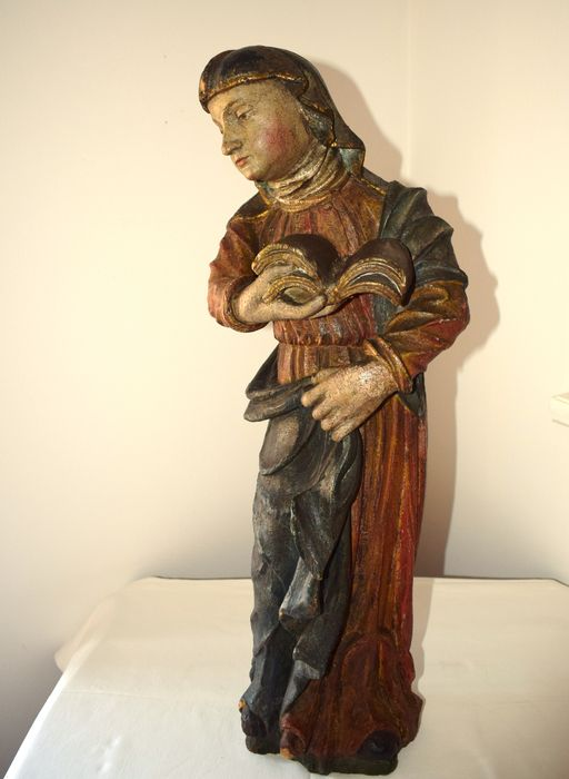 A polychrome painted and carved wood female Saint - possibly Portugal - 18/19th century