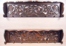 Two hand-carved hardwood coat racks, the Netherlands, first half of the 20th century