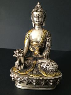 Representation of the medicinal Buddha in silver-plated and golden bronze - Nepal - end of the 20th century