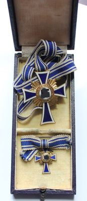 Mother Cross in Gold on Original Ribbon and in Original Case. Comes with a small, wearable version in gold.